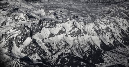 Aerial vew from the airplane at Alps under snow.