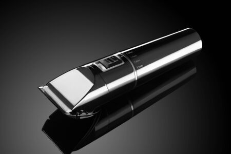 Electrical hair clipper or shaver on a dark background