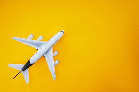Sky airplane isolated on yellow background.