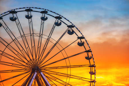 Ferris Wheel with sunset sky and clouds Stock Photo
