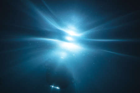 Underwater light creates a beautiful veils, consisting of sunlight. Underwater ocean waves and buoy float .