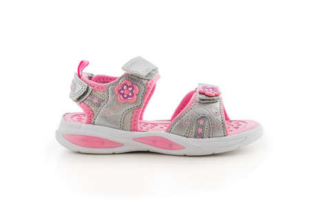 Baby girl summer sandals on white background. Kid sport shoes. Stok Fotoğraf