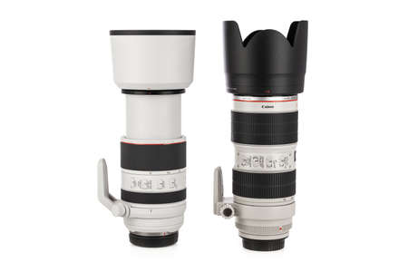 Varna, Bulgaria - August 05,2020: Image of  Canon RF 70-200mm f 2.8L IS USM and Canon EF 70-200mm f 2.8L II IS USM Lens  on a white background. Canon is the world largest SLR camera manufacturer. Editöryel