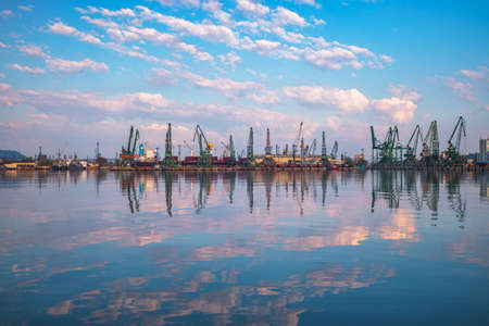 Sea port and industrial cranes, Varna, Bulgaria. Sunrise over the Varna lake