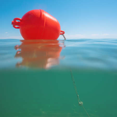Buoy float on the sea water and underwater view Stok Fotoğraf