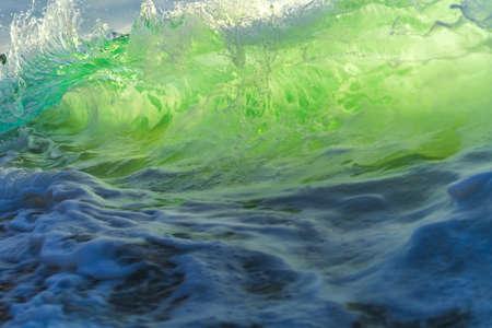 Sea wave close up, low angle view, sunrsie shot.