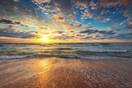 Beach sunrise over the tropical sea