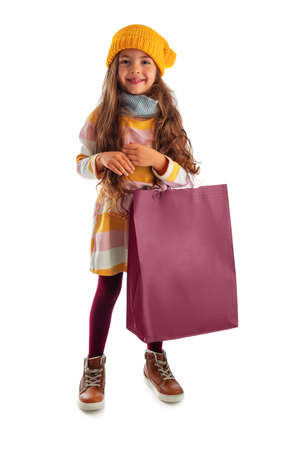 Happy beautiful young girl with shopping bag, portrait on white background