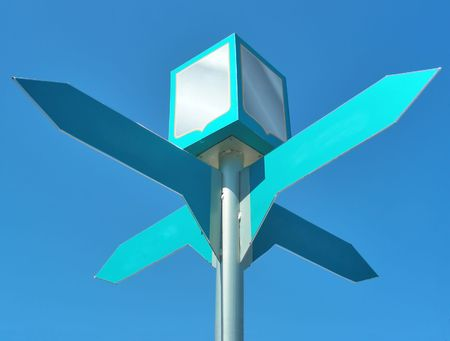 Signpost with four arrows with the blue sky behind photo