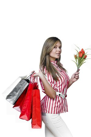 Shopping sexy woman with bag and flowers in her hand photo