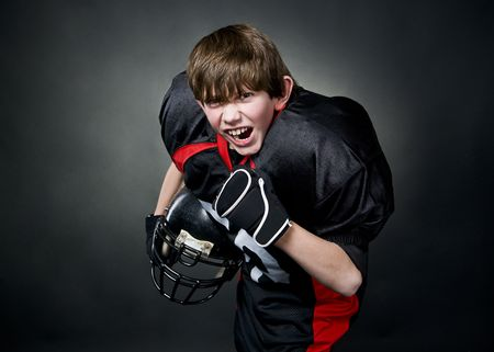 encouraged: Victorious boy after winning american football game Stock Photo