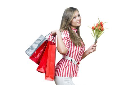 Happy lady after shopping with tulips, isolated on white photo
