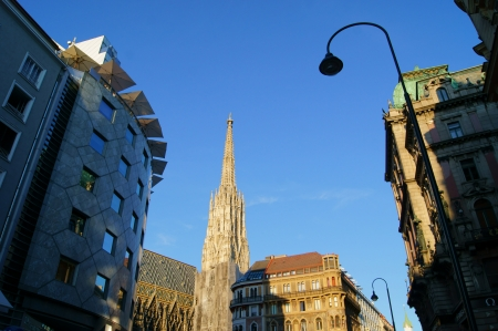 catholical: The spire of the bell tower of St. Stephens Cathedral in Vienna