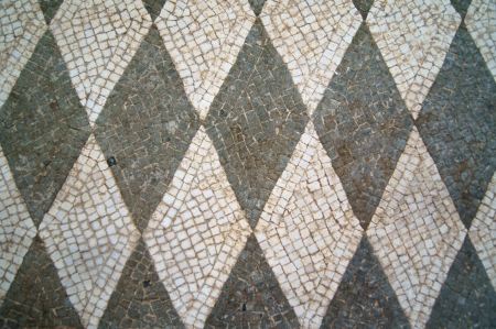 Ancient mosaic of elements of black and white photo