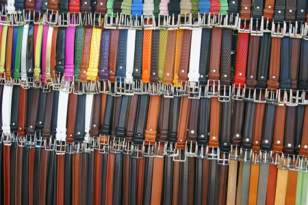 Showcase with rows of multicolored leather trouser belt Stock Photo