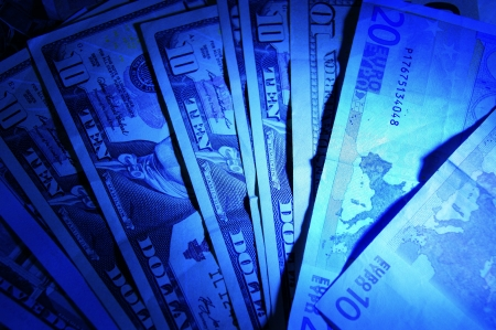 Illuminated blue banknotes, arranged like a fan Stock Photo - 15502583