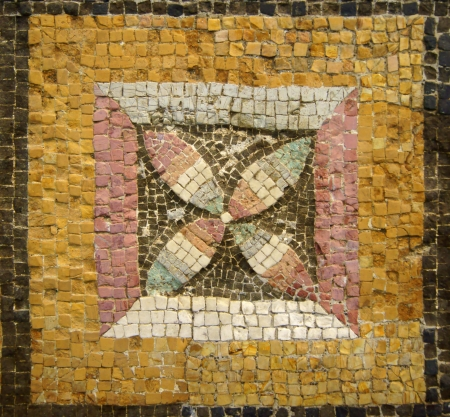 Ancient mosaic ornament with a flower yellow, black, red and green