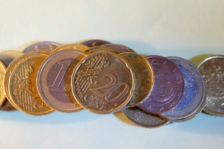 dependent: Euro coins photographed from above