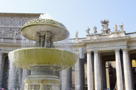 st  peter's square: Fountain on the St. Peters Square at the Vatican   Stock Photo