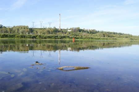 Middle reaches of the Oka River in Russia, and a pipe with high-voltage lines in the background photo