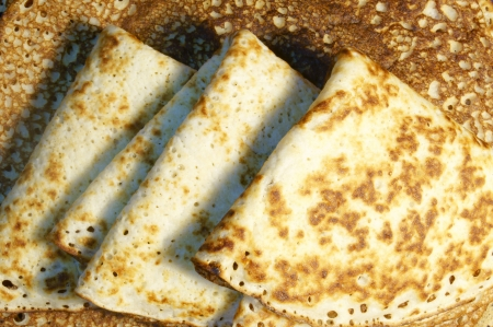 shrove tuesday: Pancakes, folded in a triangle