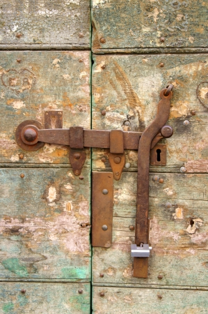 Old hasp on the door of a house in medieval Siena photo