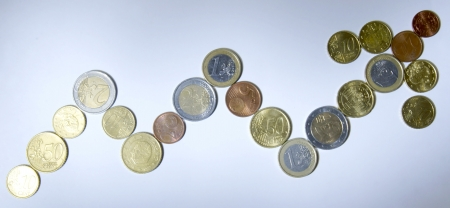 The positive trend is laid out in the form of a graph euro coins photo