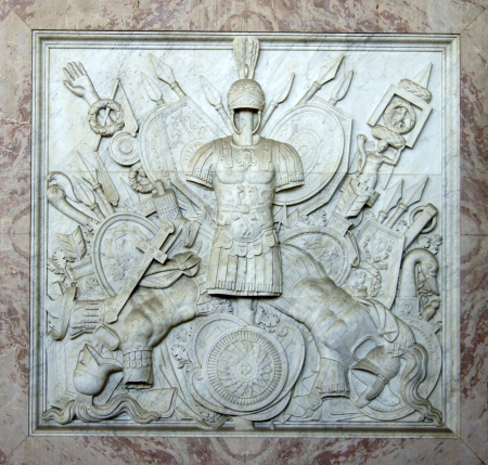 The bas-relief of the Roman theme with the armor in Neapolitan royal palace