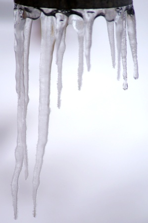 froze: Icicles on the discharge pipe Stock Photo