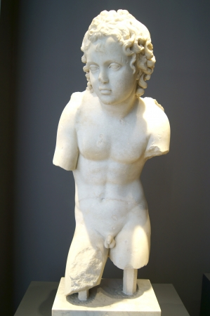 Marble statue of a boy at the Museum of Rome photo