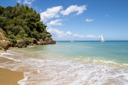 View from a sandy beach on the white yacht photo