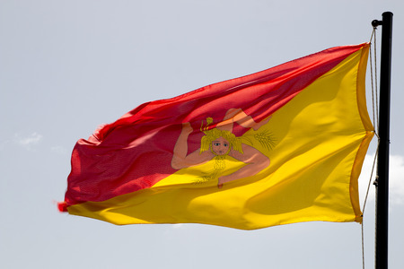 Flag of Sicily Trinacria with the image on a red-yellow background