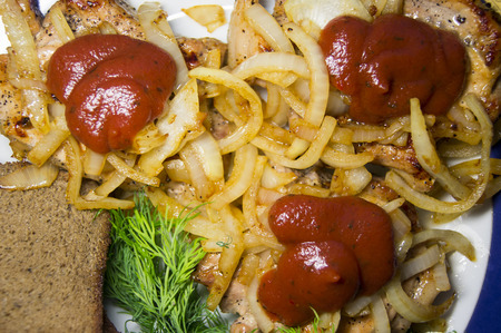 Grilled meat on a platter for pickled onions and ketchup Stock Photo