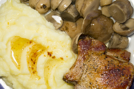 Russian food: mashed potatoes, fried meat and marinated mushrooms