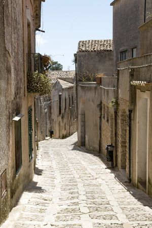 Street medieval town in the summer noon