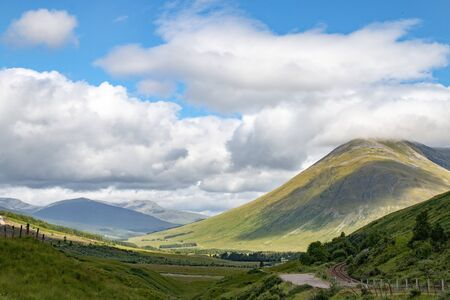 Bright mountains and valleys of Highland (Scotland) on a sunny summer day