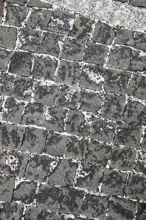 Gray stones of cobblestone pavement