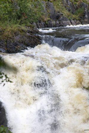 Rushing stream (waterfall) on the mountain river in Karelia