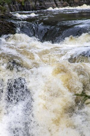 Rushing stream (waterfall) on the mountain river in Karelia