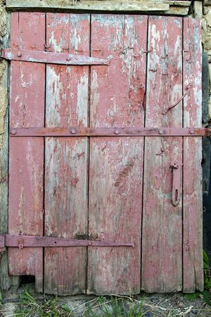Old wooden door, painted brown Stock Photo