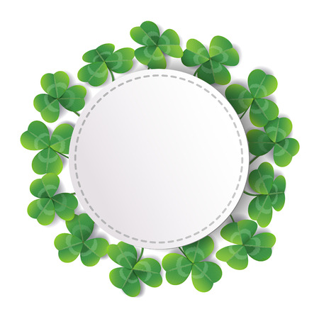 White round label decorated with fresh green leaves on white background.