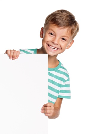 Portrait of happy little boy with white blank isolated on white background photo