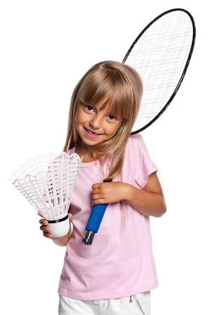 Happy little girl playing big badminton isolated on white background photo