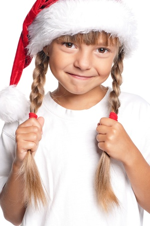 plait: Little girl in Santa hat Stock Photo