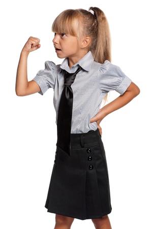 anger kid: Little girl in school uniform