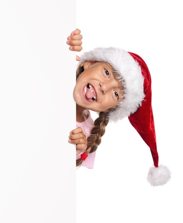 Little girl in Santa hat Stock Photo - 15315331
