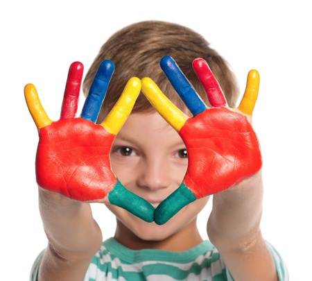 Little boy with paints on hands photo