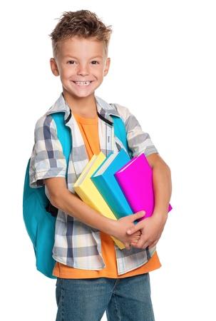 niño con mochila: Muchacho con los libros Foto de archivo