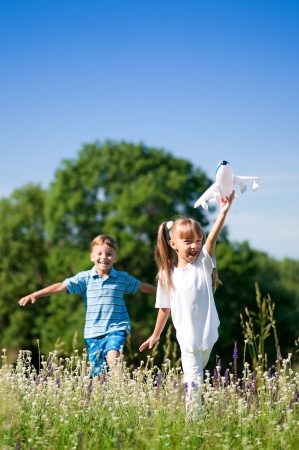 Happy children on meadow photo