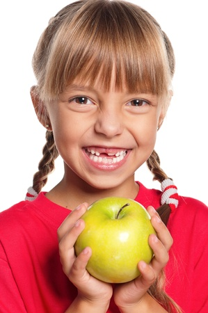 grin: Little girl with apple